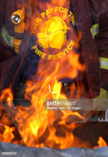 A fire fighter stands in front of a brazier at Euston Fire Station London An eight day nationwide industrial strike over a pay dispute in the fire...