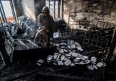 Fire fighters and hospital staff start to clear debris from the Barzulla Bone and Joint Hospital which suffered a fire incident on December 14 2013...
