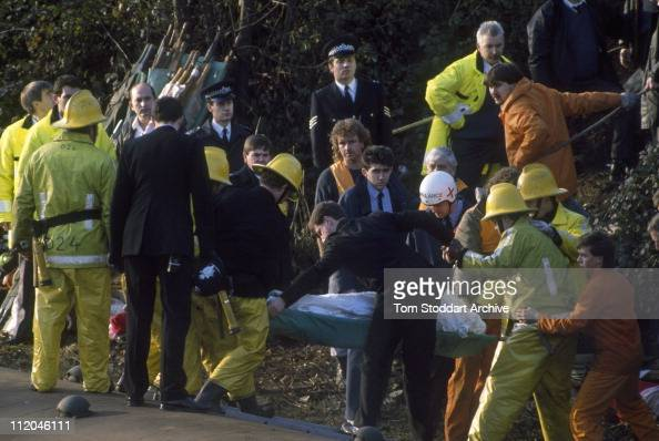 Fire fighters and policemen work to free the dead and rescue the injured from carriages after a rail crash near Clapham Junction in which 35 people...