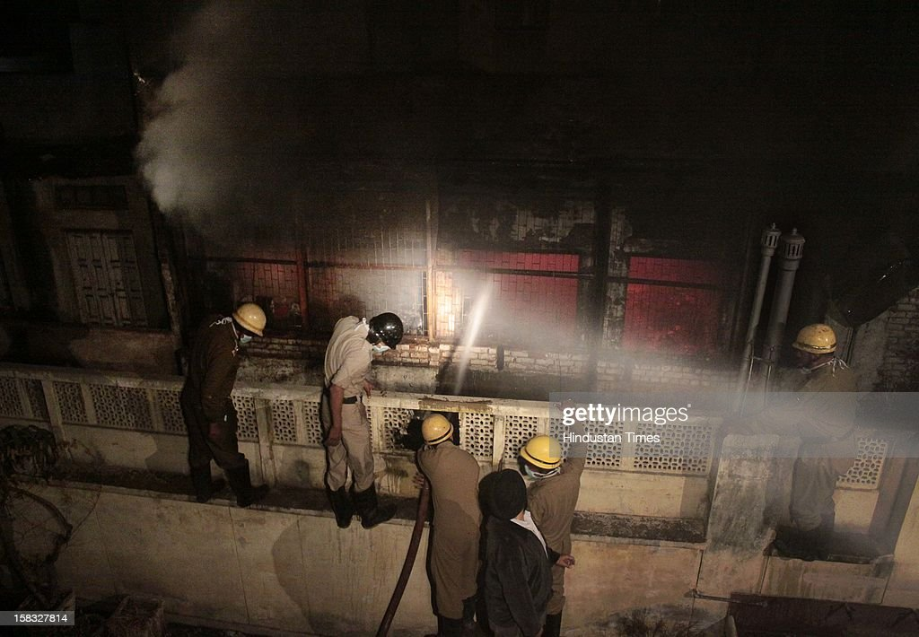 Fire fighters douse a fire at a godown in Bhagirath Palace, an electrical market of Chandni Chowk area, on December 13, 2012 in New Delhi, India. The blaze erupted at Bhagirath Palace market at around 5.10 pm and 22 fire tenders were immediately rushed to the spot. The fire is doused with no casualties reported.