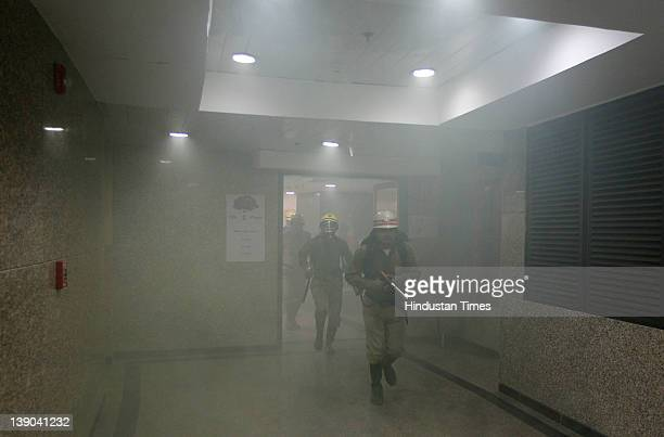 Fire fighters perform a mock rescue drill in the event of a major earthquake at Civic Center on February 15 2012 in New Delhi Various disaster...