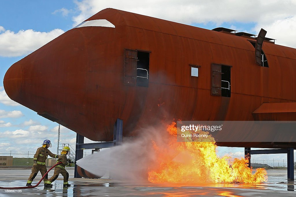 Fire fighters put on a demonstration at the Opening of Airservices Hot Fire Training Ground on April 16, 2013 in Melbourne, Australia. The rust coloured mock-up aircraft is the centrepiece of a state of the art fire training centre to be used at Melbourne Airport.