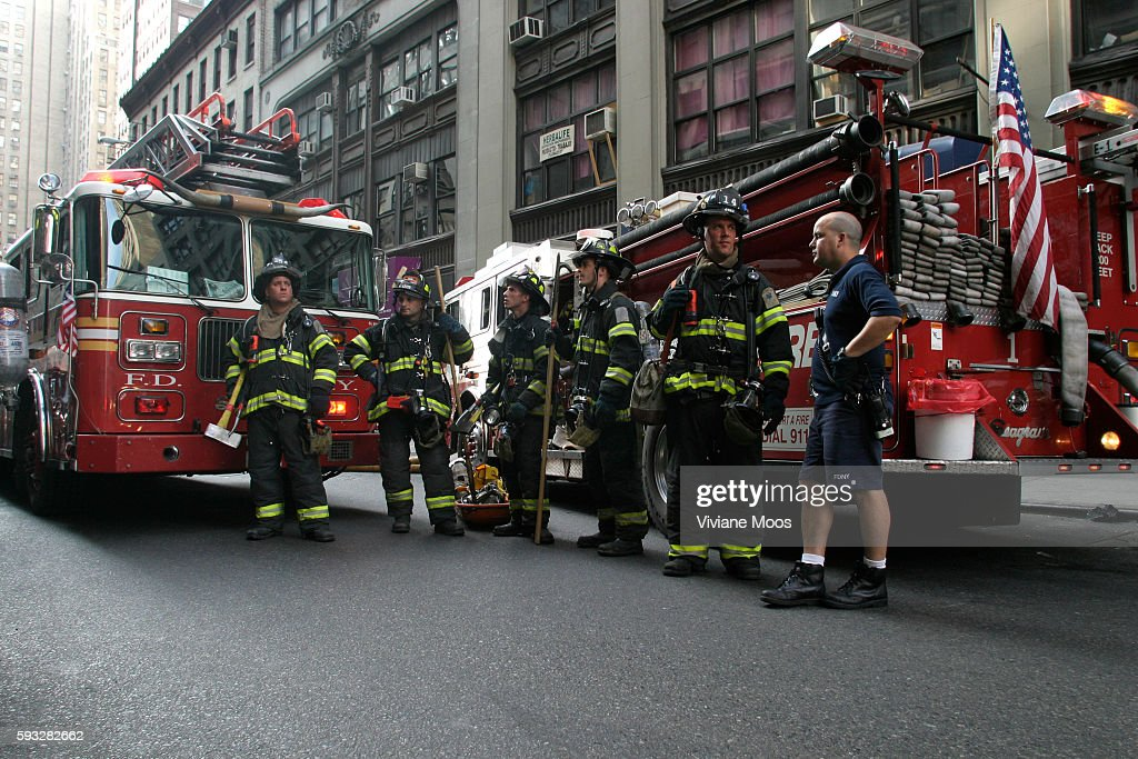 Fire fighters respond to a call inside a building in Chelsea While their buddies are inside the others wait in full gear at the ready until they get...