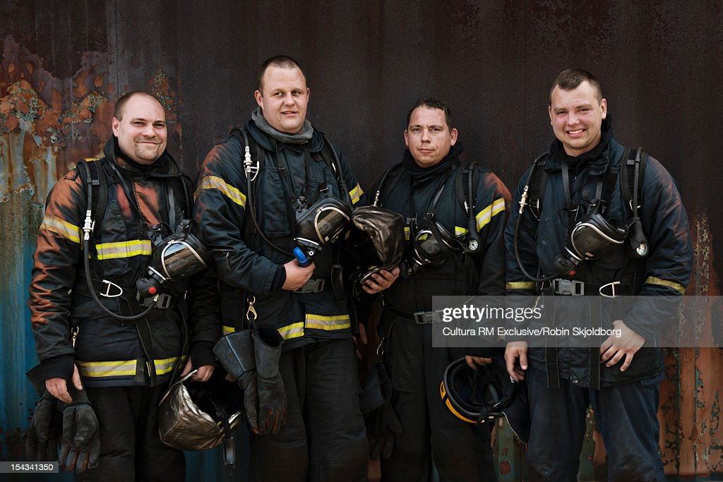 Fire fighters standing outside building