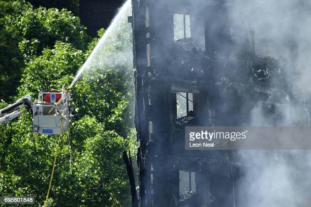 Fire fighters tackle the building after a huge fire engulfed the 24 storey residential Grenfell Tower block in Latimer Road West London in the early...