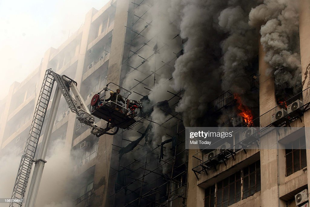 Fire fighters trying to douse a major fire that broke out in the 12-storey Himalaya Building at Connaught Place in New Delhi on Monday.