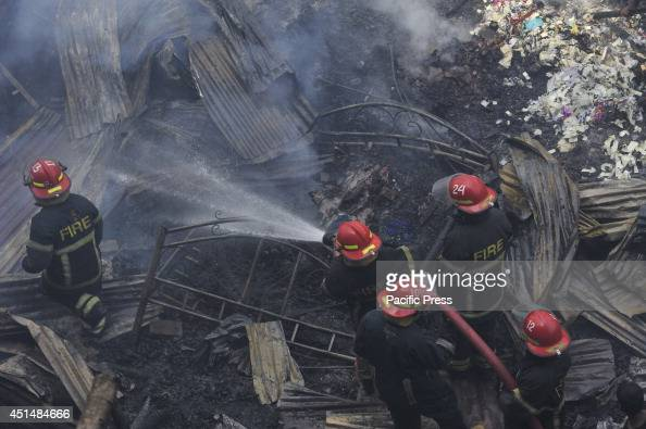 Fire fighters trying to douse the remaining fire flame in Mirpur11 Jhut Patti Bosti in Dhaka which was destroyed by fire Several people had been...