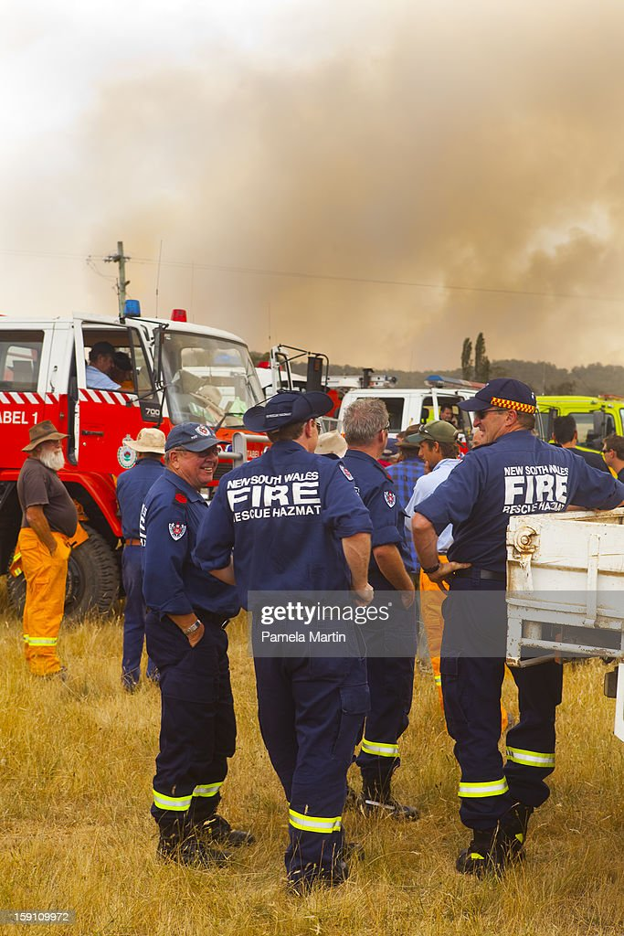 Fire Fighters wait for instruction in the Kybeyan Valley, New South Wales on January 8, 2013 in Nimmitabel, Australia. NSW was declared a total fire ban with the Illawarra, Shoalhaven and Southern Ranges regions placed on 'Catastrophic' alert.