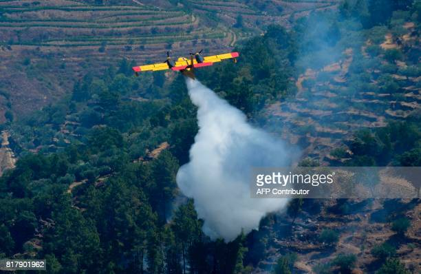 A fire fighting Canadair aircraft drops water over a fire near the village of Alijo on July 18 2017 during a wildfire A month after the deadliest...