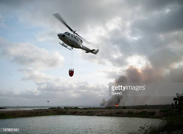 Fire fighting helicopter approaches water reservoir
