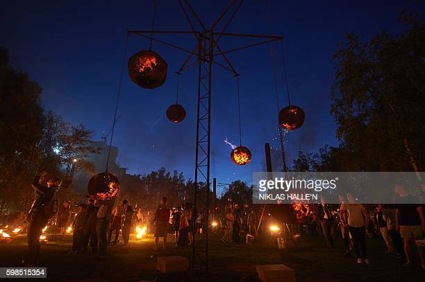 TOPSHOT A 'Fire Garden' designed by French fire masters Compagnie Carabosse is performed outside of the Tate Modern in central London as part of the...
