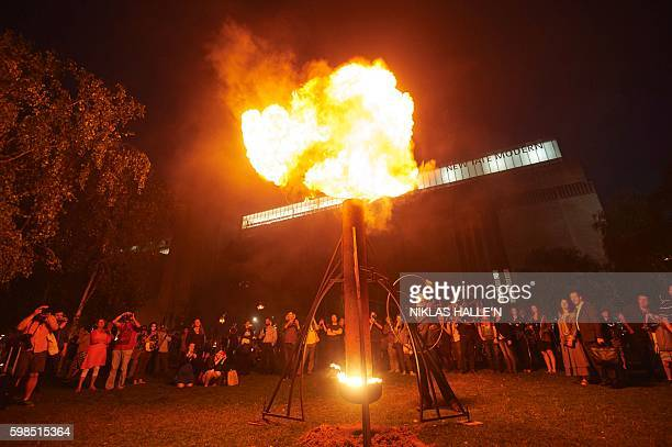 A 'Fire Garden' designed by French fire masters Compagnie Carabosse is performed outside of the Tate Modern in central London as part of the London's...