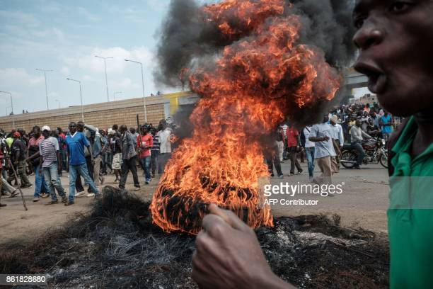 TOPSHOT A fire has been set by demonstrators on October 16 2017 in Kisumu during a rally to demand the removal of officials from national election...