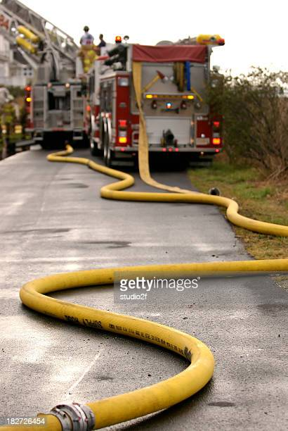 Fire hoses from hydrant to truck