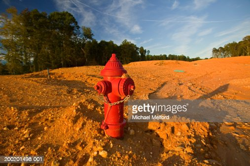 Fire hydrant in soil on construction site : Photo