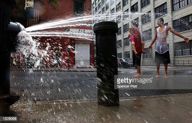 A fire hydrant provides temporary relief from the heat June 30 2001 on a Brooklyn New York street corner New York has been experiencing a week of...