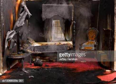 Fire in bedroom of model house, close-up