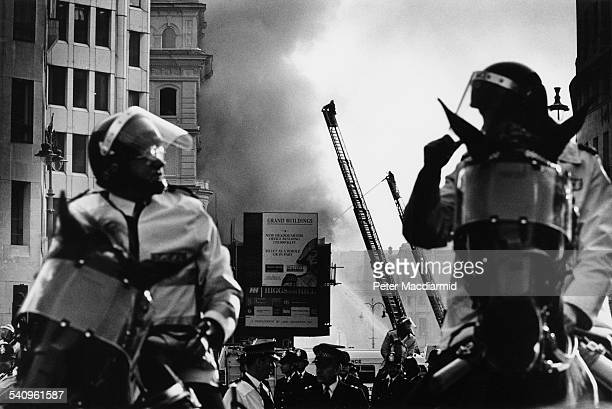 Fire in Trafalgar Square as seen from The Strand during the Poll Tax Riots in London 31st March 1990