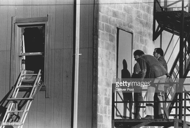 Fire Inspectors look over a second floor door to the fire escape at the back of an apartment at 3026 Gilpen the door has is ***** and pad locked...