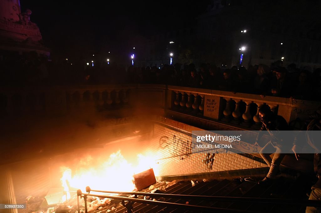 A fire is lit at the entrance of the subway station at the Place de la Republique during a protest by the Nuit Debout (Up All Night) movement against the French government's proposed labour reform, on May 1, 2016 in Paris.