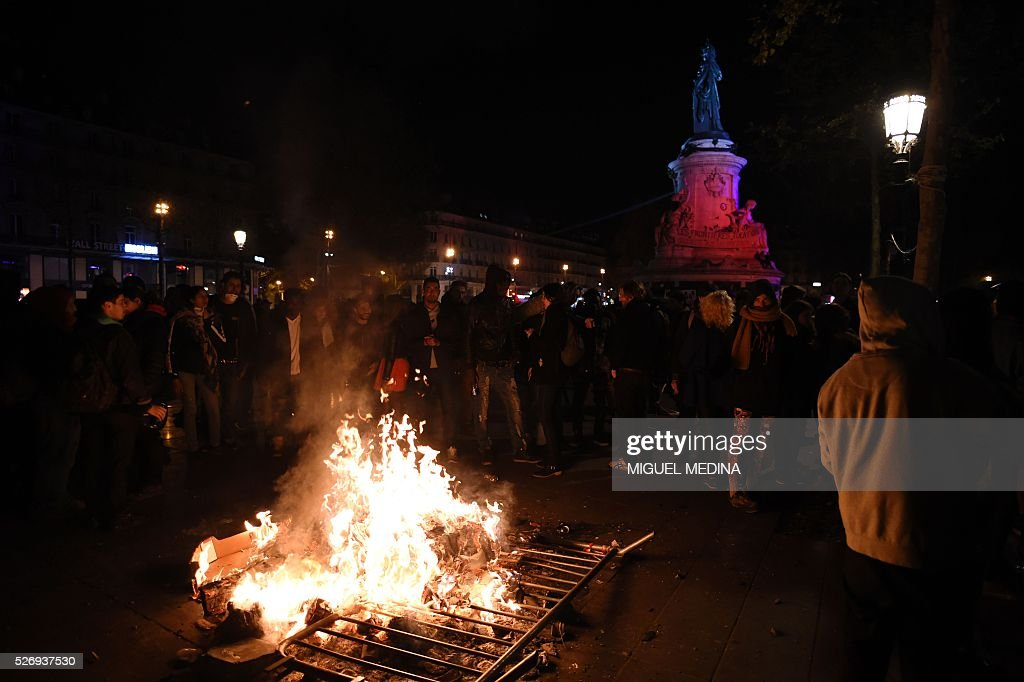 A fire is lit at the Place de la Republique during a protest by the Nuit Debout (Up All Night) movement against the French government's proposed labour reform, on May 1, 2016 in Paris.