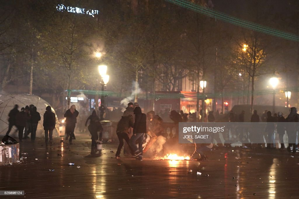 A fire is lit at the Place de la Republique in Paris during a protest by the Nuit Debout, or 'Up All Night' movement who have been rallying against the French government's proposed labour reforms on April 29, 2016. Twenty-seven people were arrested and 24 detained during the overnight clashes in the French capital as the police dispersed the protesters who began their began movement on March 31 in opposition to the government's proposed labour reforms.