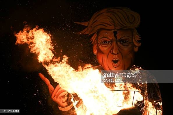 Fire licks up through an effigy of US presidential candidate Donald Trump as it is burned as the 'Celebrity Guy' at the Edenbridge Bonfire Society...