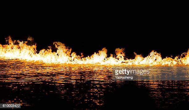 Fire on the water. Isolation on a black background