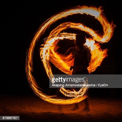 Fire Performer At Beach Against Sky