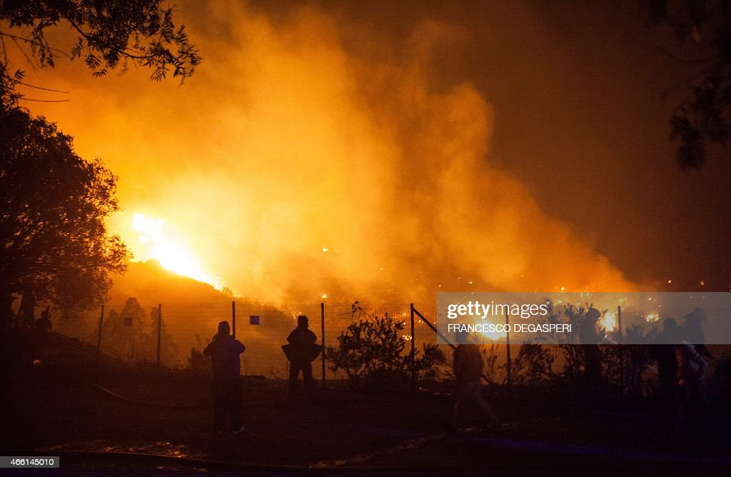 Fire rages in the forest around Valparaiso in Chile on March 13 2015 as the fire threatens to reach the city's port Authorities have declared a red...