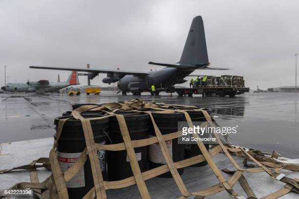 Fire retardant material is seen in front of a Royal New Zealand Air Force C130 Hercules aircraft on February 17 2017 in Christchurch New Zealand The...