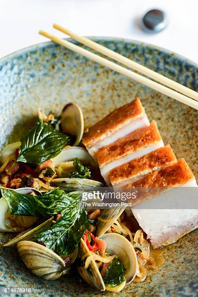 Fire roasted pork belly littleneck clams smokey chinese bacon and mustard greens at The Source