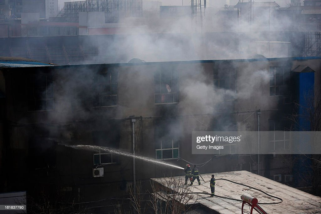 Fire services work at the site of a fire at a supermarket on February 17, 2013 in Changzhi, China. The supermarket caught fire at 4:10 a.m. today and was put out two hours later without any reports of casualties.
