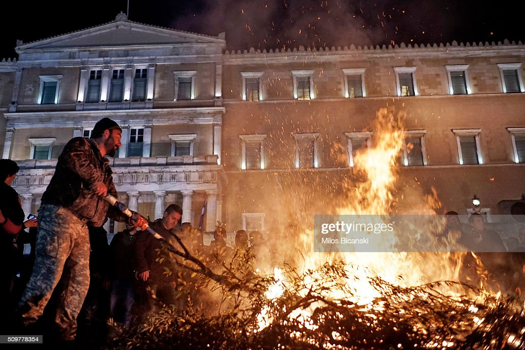 Fire set by angry farmers outside the parliament during a protest against planned pension reforms on February 12, 2016 in Athens, Greece. Farmers from across Greece gather in Athens for a two-day protest against the government and its plans to impose new tax hikes and pension charges.