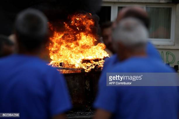 A fire set by employees burns up outside the plant of the GMS company on June 27 2017 in La Souterraine central France Around 280 jobs are on the...