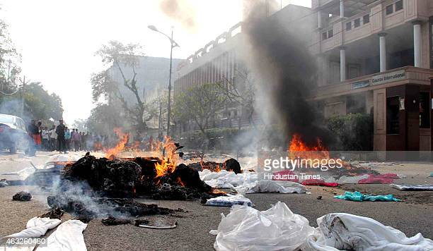 Fire setup by angry workers of garment companies at Udyog Vihar following death of an employee on February 12 2015 in Gurgaon India An angry mob of...
