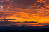 Colorful sunset over the Blue Ridge Mountains from the Woolyback Overlook along the Blue Ridge Parkway.