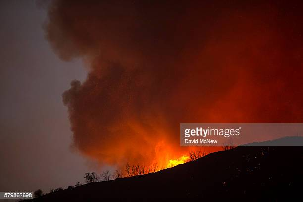 Fire spreads through the night in Placerita Canyon at the Sand Fire on July 24 2016 in Santa Clarita California Tripledigit temperatures and dry...