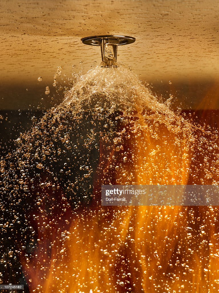 Fire Sprinkler Spraying Stock Photo Getty Images