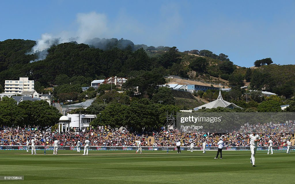 A fire starts in the hills behind the ground during day three of the Test match between New Zealand and Australia at Basin Reserve on February 14, 2016 in Wellington, New Zealand.