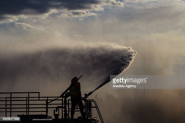Fire support crew extinguish a wildfire that erupted outside Fort McMurray Alberta Canada on May 11 2016 Wildfire erupted on 3 May consuming 200...