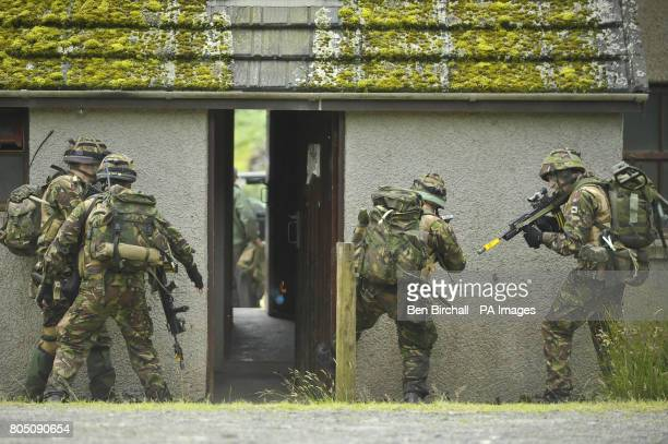 A 'fire team' of four soldiers from the 1st Battalion Royal Welsh bust open a building door and throw in a 'Flash Bang' grenade to stun any enemy...