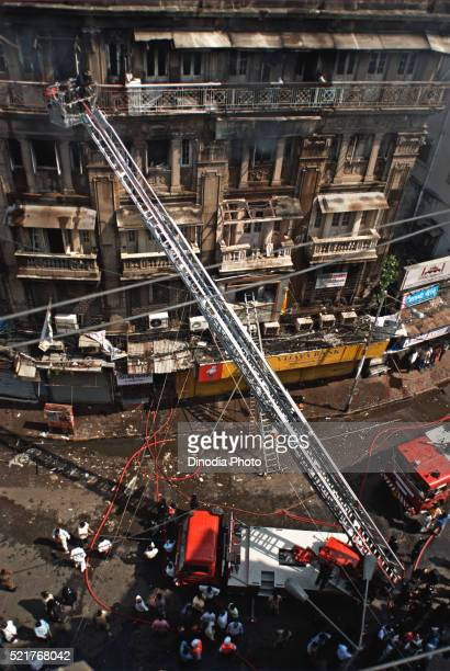 Fire tenders stands in narrow lane firemen try to douse fire in Johri Mansion at Kalbadevi, Bombay Mumbai