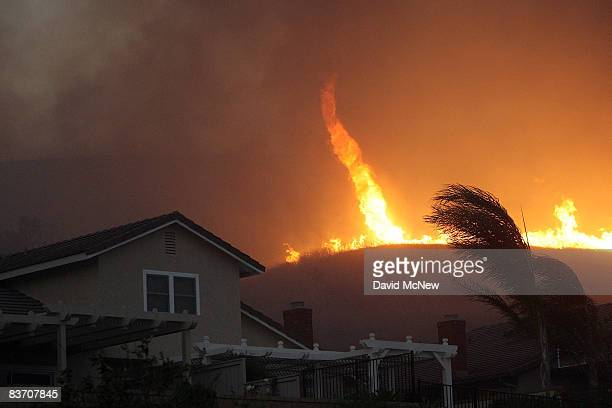 A fire tornado comes close to homes during the Corona Fire on November 15 2008 in Yorba Linda California Strong Santa Ana Winds are destroying...