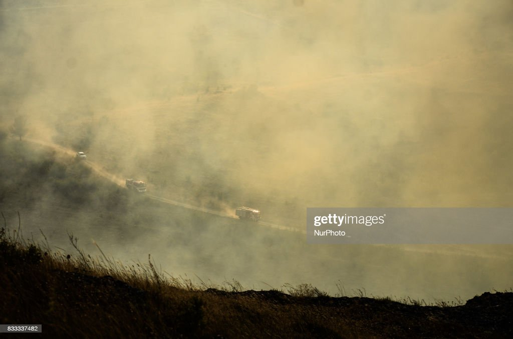 Fire truck are seen moving on the place of the fire, trying to prevent stop it and prevent the village of Matochina. Fire destroyed near 2000 acres between the villages of Sakartsi and Matochina, which are located along the Bulgarian-Turkish border fence and 270 kilometres East the Bulgarian capital of Sofia. More than 50 people, firefighters, volunteers and the people from the villages are working on place, Matochina, Bulgaria on August 16, 2017