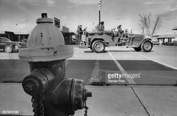 Fire Truck is Hearse for Old Friend Longmont's first motorized fire truck 'old Ironsides' passes a fire hydrant on the way to local cemetery carrying...