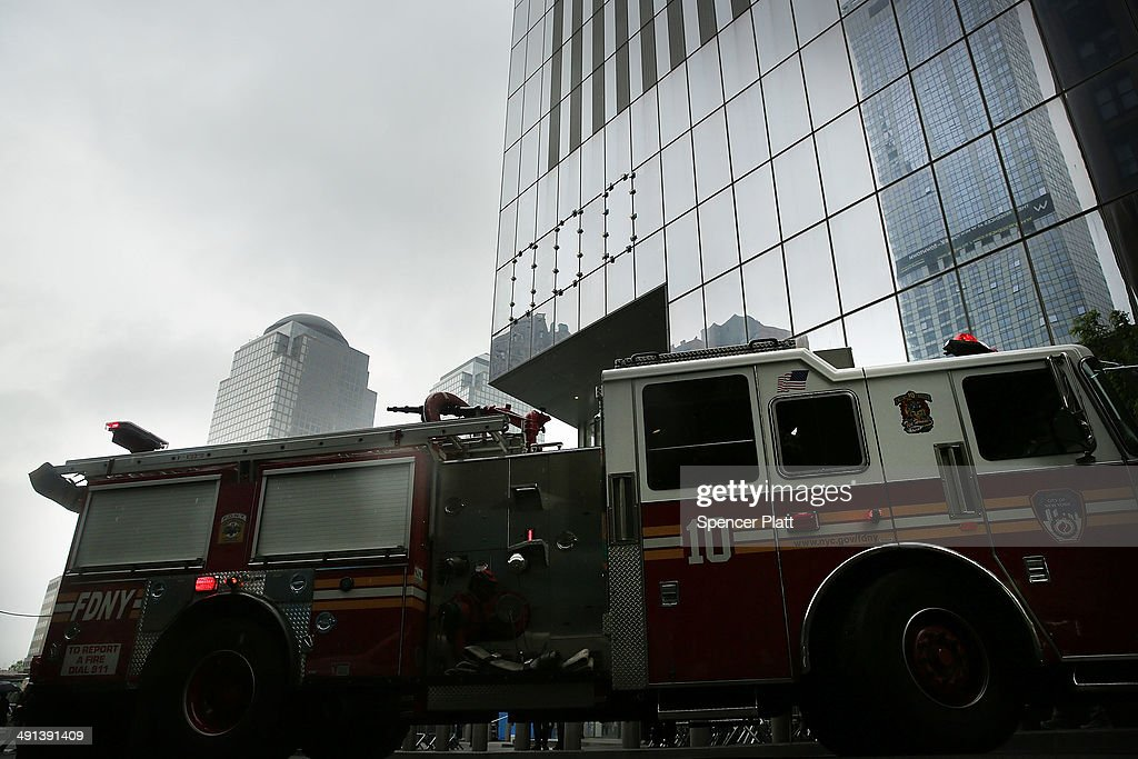 A fire truck is viewed just outside the Ground Zero memorial site after authorities opened the plaza to the public free of charge on May 16, 2014 in New York City. Prior to today, visitors had to wait in line to enter a barricaded area which includes the newly dedicated National September 11 Memorial Museum. Together with the museum, Ground Zero has become one of the top tourist attractions in the nation with tens of thousands of visitors expected yearly.