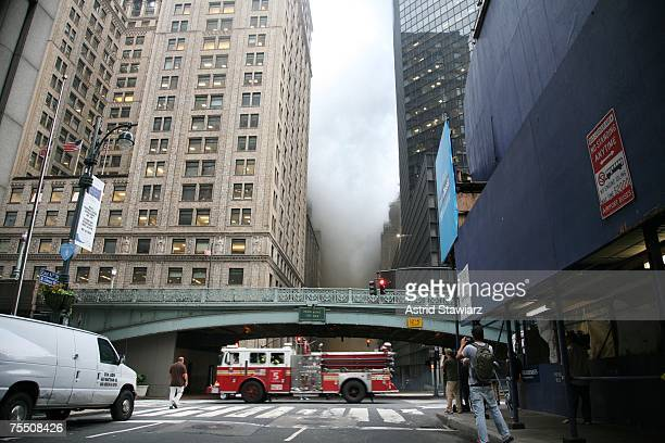 A fire truck passes as people evacuate the area around Pershing Square after a steam pipe explosion that occurred during rush hour in midtown...