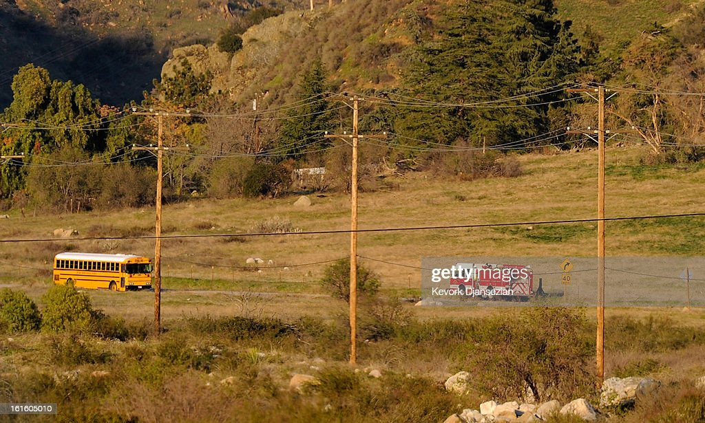 A fire truck rushes to the scene of a standoff involving the former Los Angeles Police Department officer Christopher Dorner, who is suspected of triple murder, on February 12, 2013 in Yucaipa, California. Dorner barricaded himself in a cabin near Big Bear, California and is in a standoff with authorities after shooting two police officers, killing one and wounding the other. Dorner, a former Los Angeles Police Department officer and Navy Reserve veteran, is wanted in connection with the deaths of an Irvine couple and a Riverside police officer.