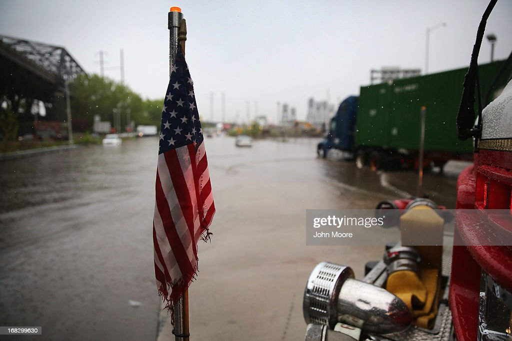 A fire truck sits at an intersetion as firemen direct traffic away from a flooded underpass on May 8, 2013 in Jersey City, New Jersey. Heavy rains flooded streets, stranding some motorists during morning rush hour traffic.